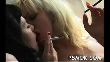 This bitch shows her giant bust while holding a cigarette