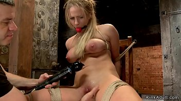 Blonde MILF slave is toyed in bondage