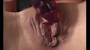 Flawless beauty poking her twat with smooth sex toy