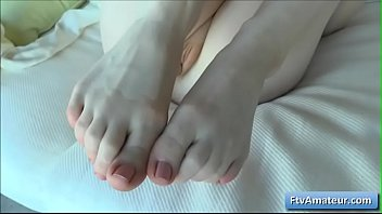 Sensual blonde teen amateur Alana has a weird foot fetish and lick her toes
