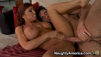 Naughty America Devon Michaels fucking in the couch with her tits