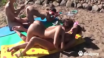 Naughty Girlfriends Have A Lesbian Orgy At A Nude Beach porn image