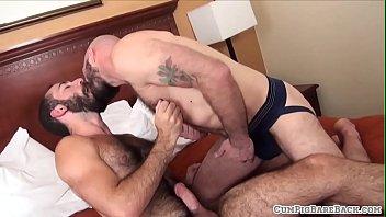 Hairy studs breeding in threesome scene