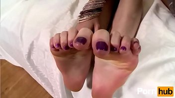 Adorable babes with sexy legs make some hot lesbian foot fetish action