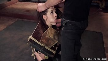 Slave in wooden stock mouth banged