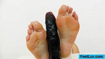 Bare feet masturbation Dark fake penis gets a footjob