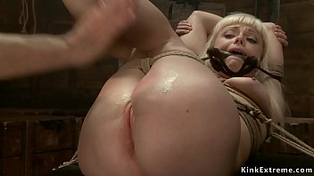 Gagged blonde is spanked on hogtie