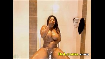 Busty horny ebony rides dildo in bathroom