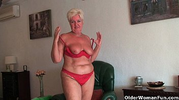Chubby granny with saggy big tits and plump ass spreads pussy image