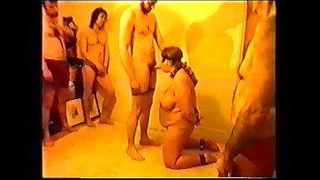 Bikini chain gang review Sex slave suzisoumise offered in chains for twelve men to fuck.