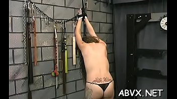 Wicked girl slowly getting naked to turn him on