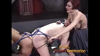 Nasty mistresses play with their slaves together in the dungeon