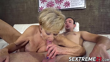 Blonde granny sucks on a younger cock and fucks it good