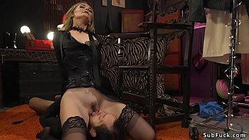 Mistress puts males head in wooden box thumbnail