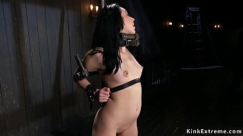 Strapped in metal device babe ass whipped