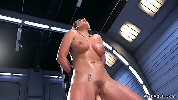 Oiled huge tits blonde fucks machine
