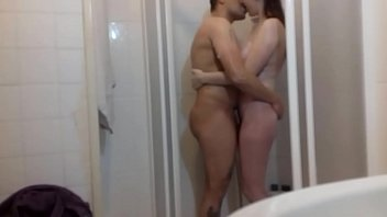 they fuck in the shower while she lets her touch her tits