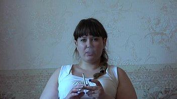 A fat girl in pantyhose smokes and then masturbates