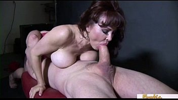 Busty cougar in stockings prefers it doggy style
