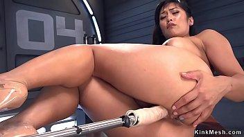 Asian takes double penetration machine