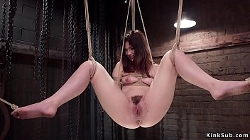 Hairy slave tormented in suspension