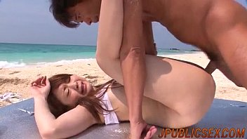 Dirty threesome porn scenes at the beach along Mayuka Akimoto