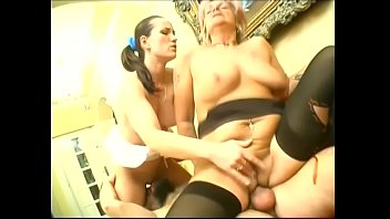 Older blonde with tramp stamp bends over to take it doggy-style
