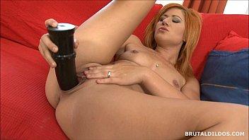 Strawberry blonde beauty swallowing a big brutal dildo Vorschaubild