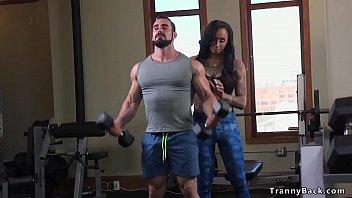 Tranny fitness instructor fucks muscled guy
