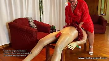 Dominatrix Mistress April - Using her rubber sex toy slave