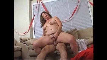 Big ass mature lady sucks and fucks a fat santa's cock on the sofa