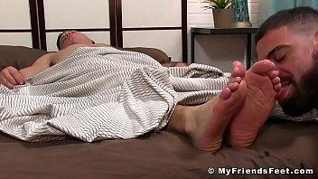 Ricky Larkin treats sleeping JC with a good foot licking