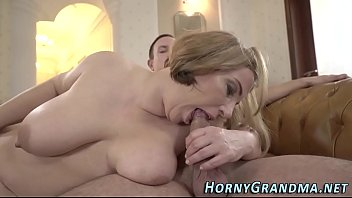 Busty granny blows dick