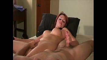 She strokes his cock and he rubs her pussy