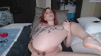 Tattooed ginger bates her pussy on webcam