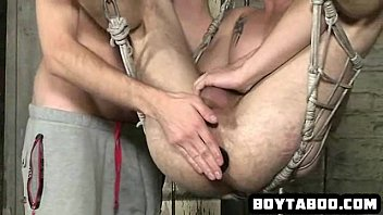 Horny hunk getting a chain stuffed deep in his ass