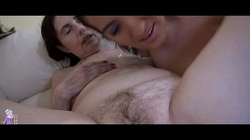 Granny is enjoying a dildo playing with younger woman