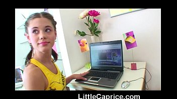 Little Caprice fooling around with her laptop