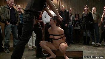 Redhead slave gags blonde in public