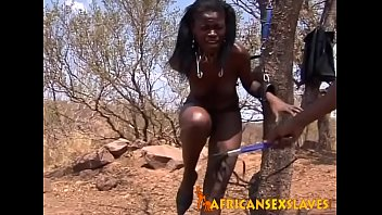 Ebony doll tied up to a tree for some sexy fun