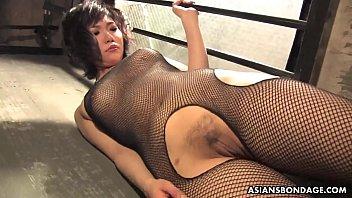 Slutty brunette in fishnet bodystocking, Kana Mimura is sucking cock