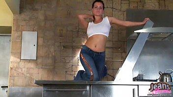 Pigtailed amateur Sara in tight blue jeans image