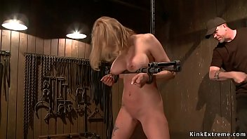 Busty hung in horizontal suspension