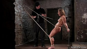 Busty babe crotch roped and hogtied