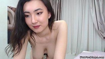 Natural busty Asian camgirl posing