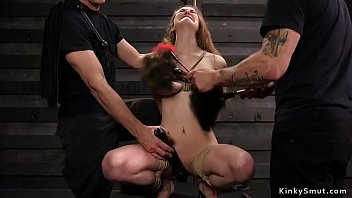 Long haired brunette slave doggy banged