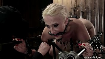 Leg chain bondage Blonde is machine fucked in device