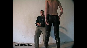 Pelosi ass kicked - Girl in leather pants kick a guy 01