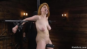 Busty sub set on a metal device bondage