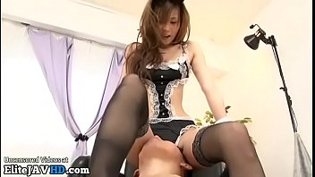 Japanese sexy maid gives footjob in stockings